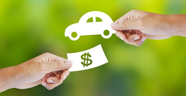 Image of cash in one hand & car
